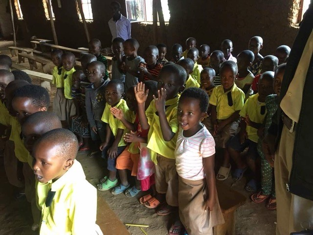 Rwandan children line up in class